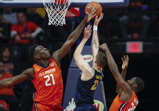 Illinois' Kofi Cockburn reaches to block the shot of Michigan's Franz Wagner during the first half December 11, 2019 in Champaign, Illinois.