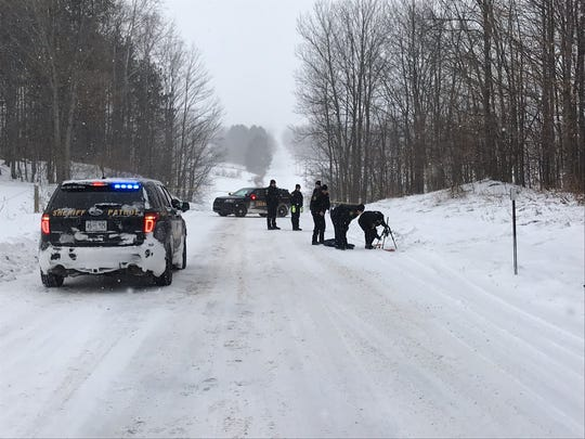 A woman's body was dragged over a snowy hill and left in a rural area in northern Michigan Wednesday, Dec. 11, 2019, police said.