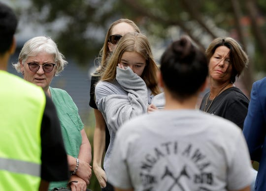 Family of volcano victim Hayden Marshall-Inman, walks from a meeting with Police Minister Stuart Nash and officials in Whakatane, New Zealand, on Thursday.