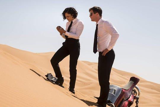 "Tessa Thompson and Chris Hemsworth in ""Men in Black: International."""