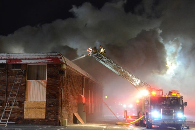 In a Tuesday, Dec. 10, 2019 photo, firefighters battle a fire at a motel in Battle Creek, Mich., on the same day that the property was closing for 90 days due to allegations of drug dealing, prostitution and other illegal activity.