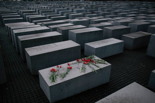 Flowers lay on a concrete slab of the Holocaust Memorial to mark the International Holocaust Remembrance Day in Berlin.