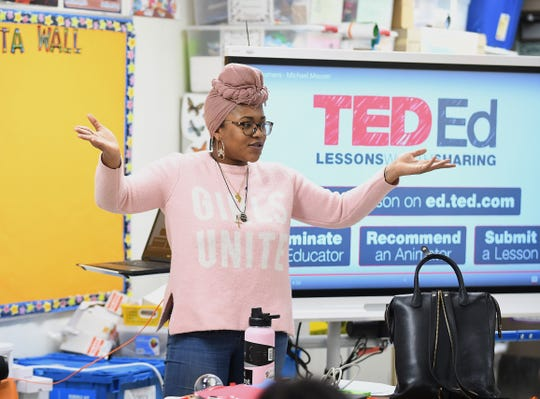 Green School lead coordinator Eradajere Oleita speaks to Clippert Multicultural Magnet Honors Academy students about real world activities off campus during a recent visit to the Detroit school.