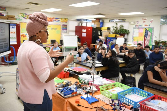 Green School lead coordinator Eradajere Oleita  speaks to Clippert Multicultural Magnet Honors Academy students about real world activities off campus during a visit to the Detroit school on Wednesday, December 11, 2019.