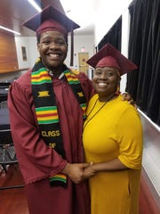 Stephan Wilson poses with his mother Sharonda after they both received their degrees at Central Michigan University's May commencement. Sharonda received her degree even though she attended Ferris State University