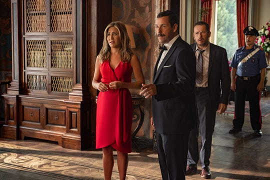 "Jennifer Aniston, Adam Sandler, and Dany Boon in ""Murder Mystery."""