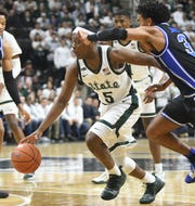 Michigan State guard Cassius Winston engineers an offense that ranks No. 1 overall, according to KenPom, but just 117th in adjusted tempo.