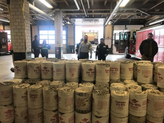 U.S. Ecology employees began transporting pails of firefighting foam containing PFAS from the Lansing Fire Department to a truck on  Thursday, Dec. 12, 2019. The effort was part of a $1.4 million to collect and dispose of the foam.