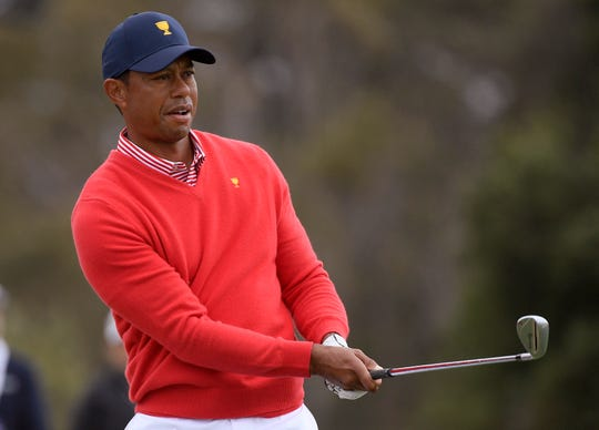 U.S. team player and captain Tiger Woods watches his approach shot on the 6th hole during their fourball match Thursday at the Royal Melbourne Golf Club in the opening rounds of the Presidents Cup in Melbourne.