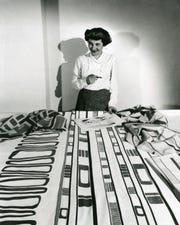 Famed designer Ruth Adler Schnee works with her iconic prints.
