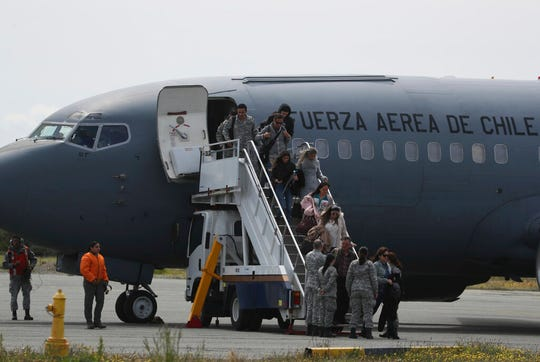 Relatives of passengers of a missing military plane arrive in a Chilean military airplane to an airbase in Punta Arenas, Chile, Wednesday, Dec. 11, 2019.
