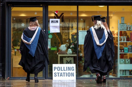 Students from the University of Reading arrive to vote in the general election, in Reading, England on Thursday.