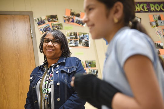 Clippert Multicultural Magnet Honors Academy teacher Tracy Ortiz (left), listens to student Ashley Azpetia as she speaks about Mrs. Ortiz's program to engage students in real world activities off campus.