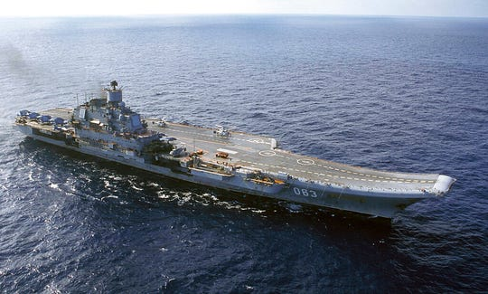 In this 2004 file photo the Admiral Kuznetsov aircraft carrier seen in the Barents Sea, Russia. The Admiral Kuznetsov was docked in Murmansk in northern Russia for an upgrade when the fire started amid welding work on Thursday morning.