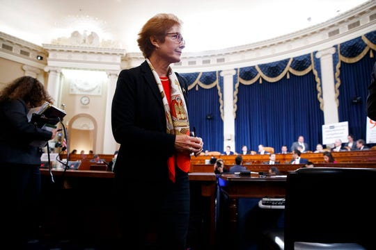 Former U.S. Ambassador to Ukraine Marie Yovanovitch gets up during a break in testimony before the House Intelligence Committee, Friday, Nov. 15, 2019, in the second public impeachment hearing of President Donald Trump's efforts to tie U.S. aid for Ukraine to investigations of his political opponents.