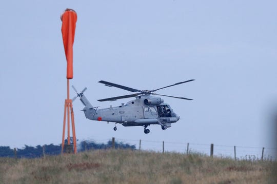 A New Zealand Navy helicopter takes off from Whakatane Airport as the mission to return victims of the White Island eruption begins in Whakatane, New Zealand, Friday, Dec. 13, 2019. A team of eight New Zealand military specialists landed on White Island early Friday to retrieve the bodies of victims after the Dec. 9 eruption.