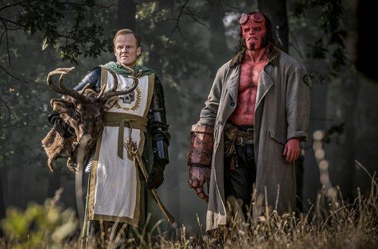 "Alistair Petrie and David Harbour in ""Hellboy."""