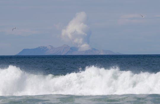 Plumes of steam rise above White Island off the coast of Whakatane, New Zealand on Thursday.