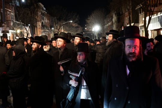 Orthodox Jewish men attend Moshe Deutsch's funeral, Wednesday, Dec. 11, 2019 in the Williamsburg neighborhood of New York.
