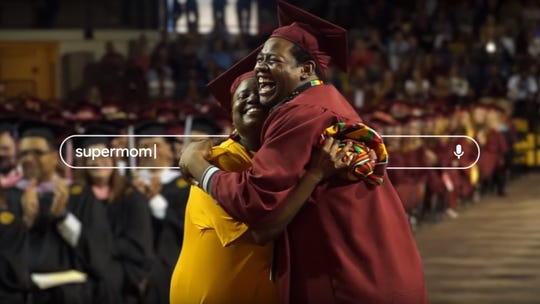 Sharonda and Stephan Wilson hug during Stephan's commencement ceremony at Central Michigan University