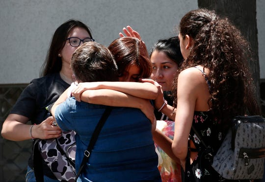 Relatives of passengers of a missing military plane comfort each other as they arrive at the Cerrillos airbase in Santiago, Chile, Tuesday, Dec. 10, 2019.