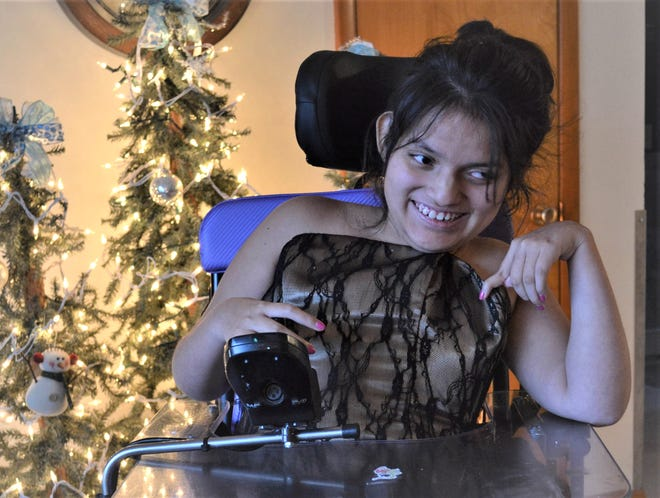 Millie Ortiz Gonzalez of Fremont models the prom dress she wore last year to Night to Shine. Terri Blue, who is Gonzalez's caregiver through Riverview Industries, said Gonzalez had a wonderful time at the prom and is looking forward to this year's event.