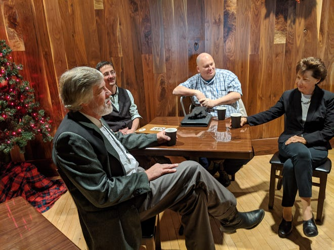 Chris Gibbs, left, a Fourth Congressional candidate hopeful, meets with Fremont residents Andy Roberts, Lee Bowling and former Fourth Congressional District candidate Janet Garrett Thursday at Down Thyme Cafe.