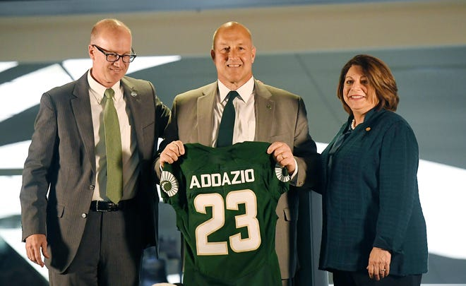 Colorado State head football coach Steve Addazio holds a jersey beside Colorado State athletic director Joe Parker and Colorado State president Joyce McConnell during a press conference after Addazio's hiring at Colorado State University in Fort Collins, Colo. on Thursday, Dec. 12, 2019.