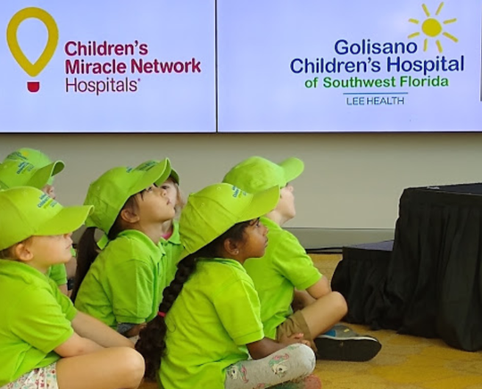 Children in day care program at Golisano Children's Hospital listen to announcement the Lee Health facility is now part of the Children's MIracle Network of hospitals.