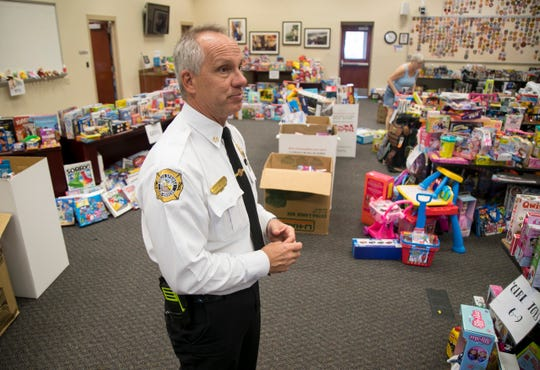 Greg DeWitt shows the room where toys for the Bonita Springs Fire District's Christmas toy drive are stored and sorted.