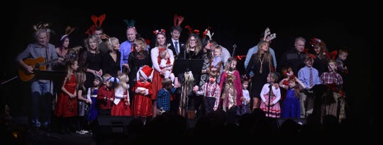 Julian Hagen, at far left, leads the Hagen Family Christmas concert at Third Avenue Playhouse in Sturgeon Bay.