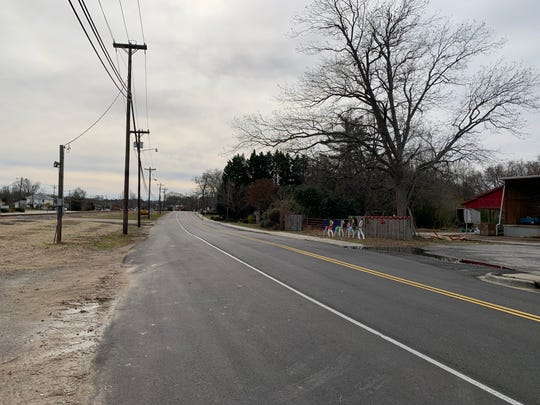 A newly-paved path along South Main Street and the railroad tracks in Simpsonville is planned to eventually connect with the Prisma Health Swamp Rabbit Trail. The path's start point at Trade Street is pictured on Wednesday, Dec. 11, 2019.