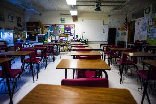 Empty desks sit in a classroom at East Middle School on Friday, Nov. 4, 2016.