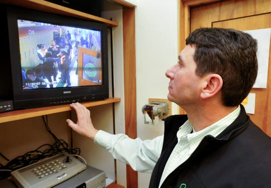 Detective Mike Stimac, an SRO based at East Middle School, archives video from hallway cameras Friday, Feb. 4, 2011.