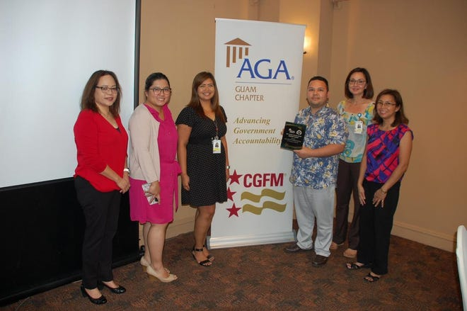 The Association of Governmental Accountants Guam Chapter presented the third-place award for fiscal year 2018, Citizen-Centric Report to the Guam Memorial Hospital Authority. The ceremony was held at the Hilton Hotel during the monthly general membership meeting held Nov. 20. From left: Doreen Crisostomo, accountability director; Debbie Ngata, AGA-Guam president; Rodalyn Gerardo, chief auditor (GMHA); Theo Pangelinan, administrative officer (GMHA); Yuka Hechanova, acting chief financial officer (GMHA); and Pilar Pangelinan, AGA-Guam president-elect.
