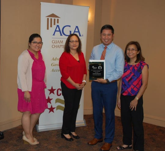 The Association of Governmental Accountants Guam Chapter presented the second-place award for fiscal year 2018, Citizen-Centric Report to the Judiciary of Guam on Nov. 20, 2019. From left: Debbie Ngata, Doreen Crisostomo, Shawn Gumataotao, director of policy planning and community relations (JOG) and Pilar Pangelinan.