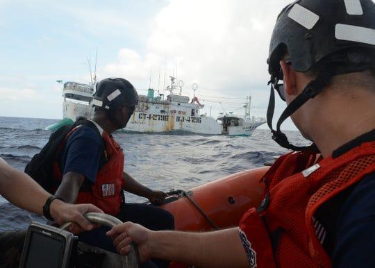 A Coast Guard Cutter Washington boarding team approaches a fishing vessel during Operation Kurukuru off Palau, Oct. 10, 2019.
