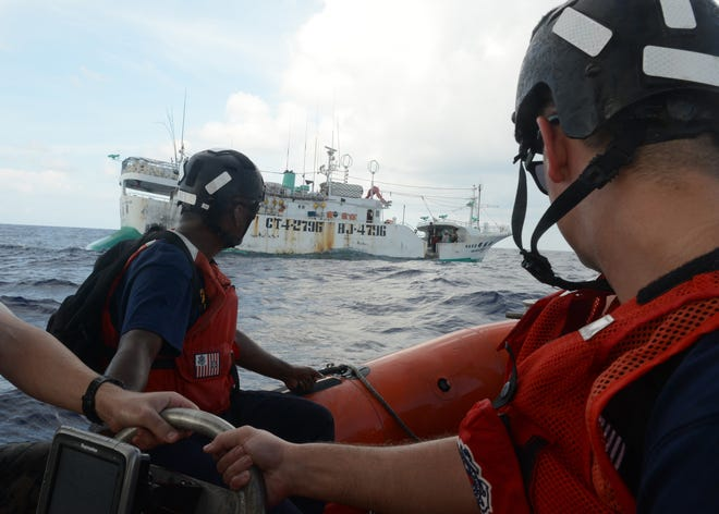 A Coast Guard Cutter Washington boarding team approaches a fishing vessel during Operation Kurukuru off Palau, Oct. 10, 2019.
