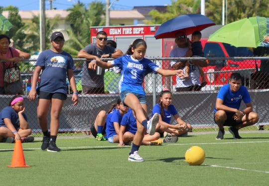 "The Merizo Martyrs Memorial School kickball team plays against J.Q. San Miguel Elementary School in the first match of the second annual Guam Police Department Fade Away from Violence ""Choosing to Be Drug and Alcohol Free"" Kickball Tournament Dec. 7 at the Guam Football Association National Training Center."