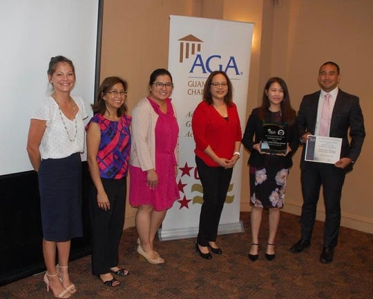 The Association of Governmental Accountants Guam Chapter presented the first-place award for fiscal year 2018, Citizen-Centric Report to the Office of Attorney General on Nov. 20. From left: Carlina Charfauros, public information officer (OAG); Pilar Pangelinan, Debbie Ngata, Doreen Crisostomo, Jessica Herrera and Attorney General Leevin Camacho.