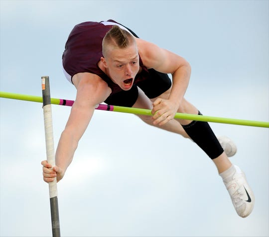 After winning the state pole vault championship with a jump of 14-6, Henderson County's Cain Cooper breaks a 45 year school record by jumping 15-1 at the state track and field championships in Louisville May 18, 2013.