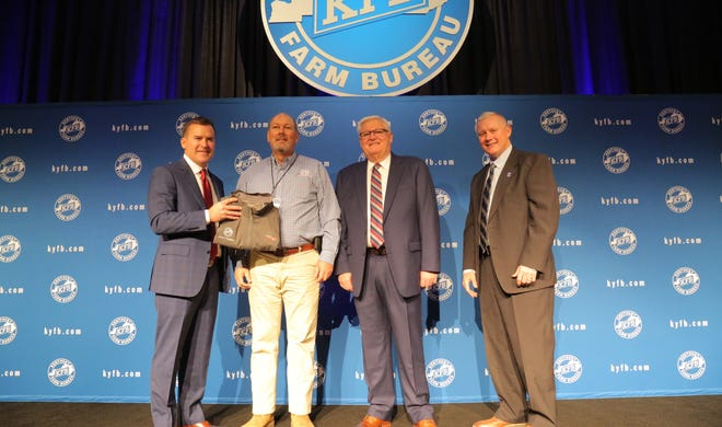 Henderson County Farm Bureau was recognized during the 100th Kentucky Farm Bureau (KFB) annual meeting in Louisville for its outstanding membership and program achievement in 2019. The award honors county Farm Bureau offices who meet the company's profitability requirements and whose insurance policy growth meets or exceeds its annual growth goal. In photo above, Bob Watson, President of Henderson County Farm Bureau (center left), accepts the award from John Sparrow, Executive Vice President and CEO of KFB Insurance (left), Mark Haney, President of Kentucky Farm Bureau (center right), and Drew Graham, Executive Vice President of the KFB Federation (right), during a Dec. 6 recognition and awards program.