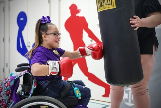 Linda Duarte, 10,  jabs a punching bag at Riley Hospital for Children in Indianapolis on Wednesday, Dec. 11, 2019.