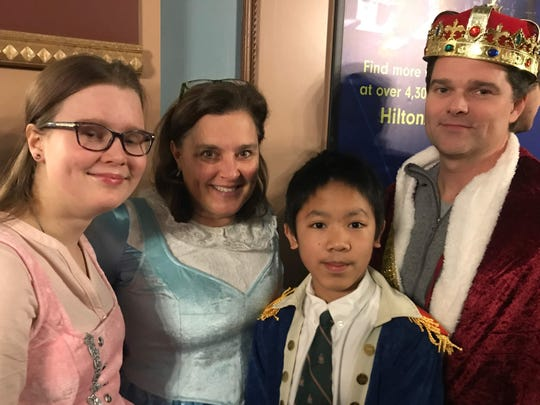 """The Poertner family, from left, Julia, Bobbi, Thanh and Josh, dressed as """"Hamilton"""" characters Wednesday at Old National Centre."""