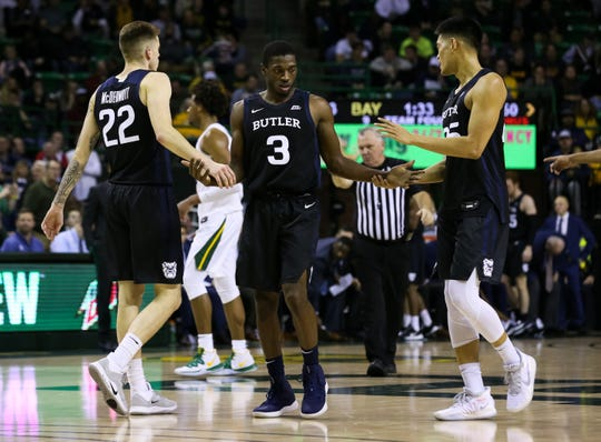 Butler forward Sean McDermott (22) and guard Kamar Baldwin (3) and forward Christian David (25) come back onto the court after a timeout against Baylor.