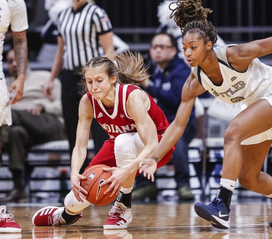 Indiana Hoosiers guard Ali Patberg (14) reaches for the ball after Butler Bulldogs guard Genesis Parker (2) attempts a steal at Hinkle Fieldhouse, Indianapolis, Wednesday, Dec. 11, 2019. IU defeated Butler, 64-53.
