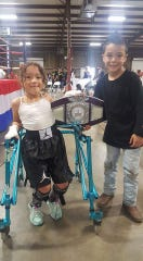 Linda Duarte with her twin brother, Killian, after a bout.