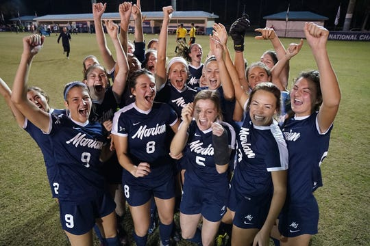 Marian soccer celebrates during its run at NAIA national championships. The team finished runner-up and was part of Marian's dominant athletics run.
