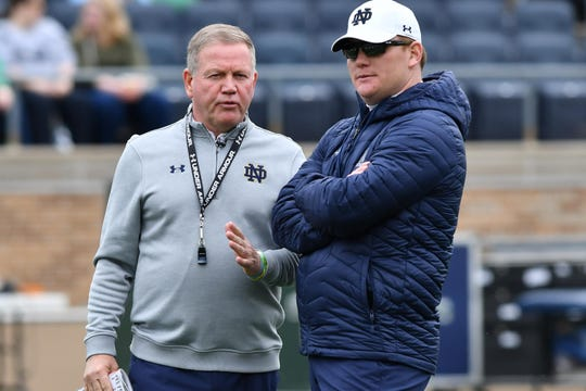 Brian Kelly and Notre Dame have reportedly parted ways with offensive coordinator Chip Long (right).