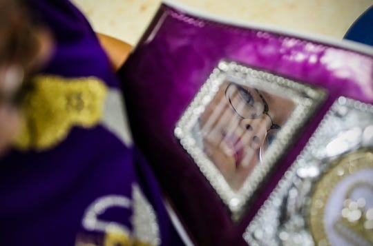 Linda Duarte, 10, is reflected in her championship boxing belt at Riley Hospital for Children in Indianapolis on Wednesday, Dec. 11, 2019.